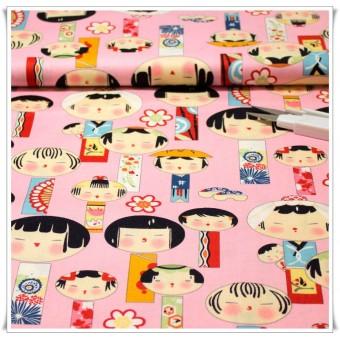 Tela japoneses kokeshi fondo rosa