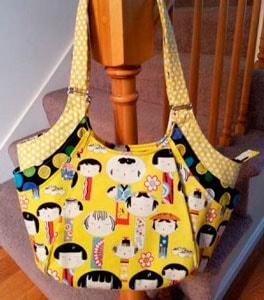 Bolso con tela de kokeshi amarilla