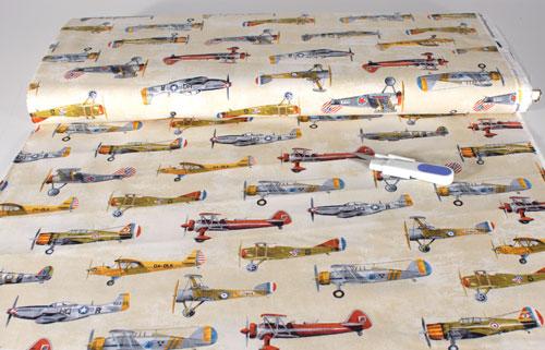 Tela con dibujos de avionetas