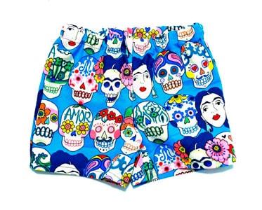 Pantalones con tela Frida calaveras turquesa