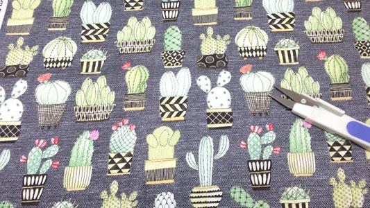 Detalle tela algodon con dibujos de cactus