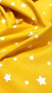 Detalle tela estrellitas amarillo
