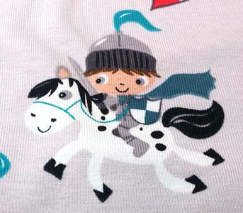Tela de punto detalle caballero con caballo