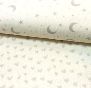 Telas de pique con lunas y estrellas