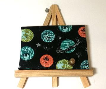 tela enmarcada planetas